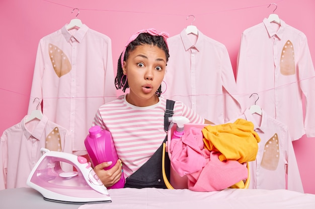 Stunned housekeeper strokes clothes. housekeeping concept
