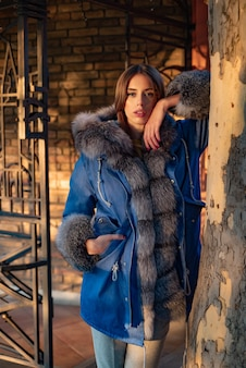 Stunning beauty. modern fashion outfit. woman enjoy sunny day outdoors. fall season outfit. autumn season. gorgeous pretty woman furry coat jacket stand nature background. her confidence is stunning.