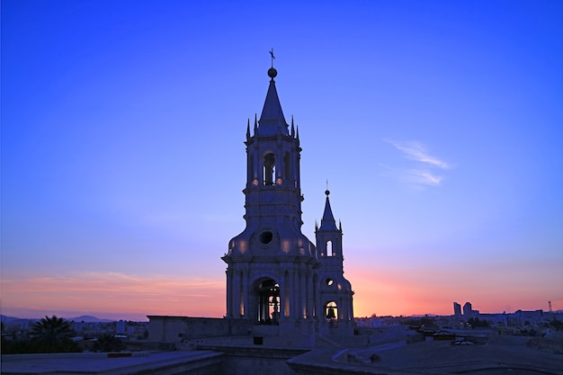 Stunning bell tower of basilica cathedral of arequipa against sunset afterglow sky, arequipa, peru