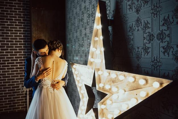 Stunning sensual portrait of young stylish wedding couple.