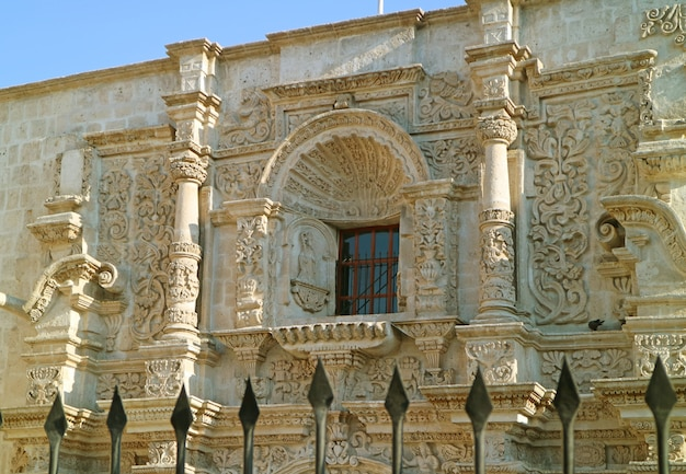 Stunning sillar stone carving facade of the church of saint augustine in arequipa, peru