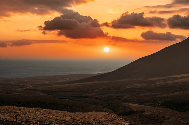 Stunning sunset over hilly island