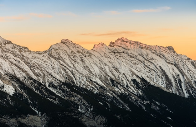 Stunning sunset of snow capped canadian rocky mountains at banff national park in alberta, canada