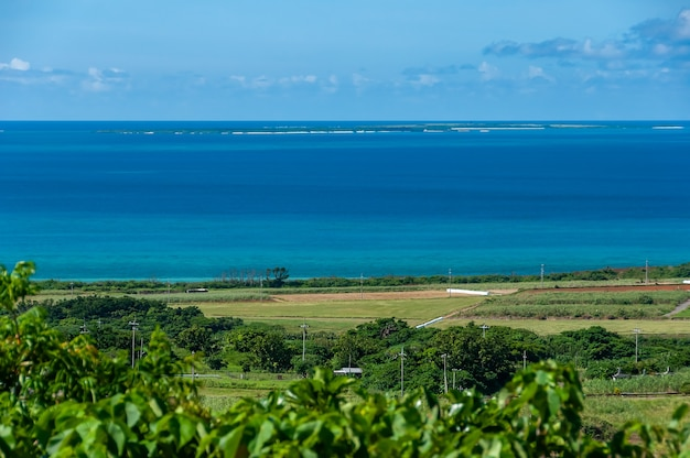 Stunning top view of deep blue sea islands and green fields
