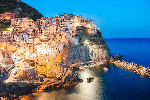 Stunning view of the beautiful and cozy village of manarola in the cinque terre reserve at sunset,