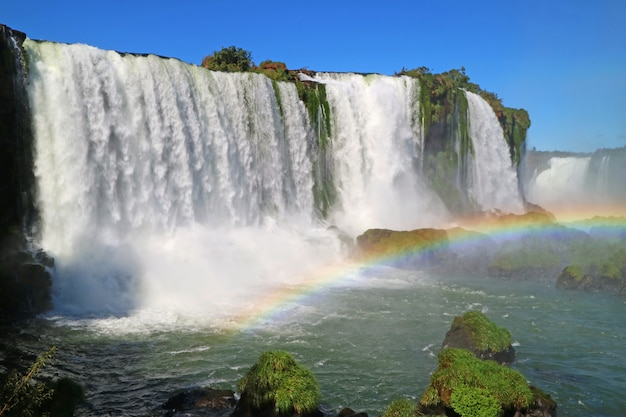 Stunning view of the powerful iguazu falls with beautiful rainbow, foz do iguacu, brazil