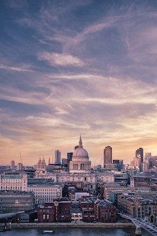 A stunning view of st paul's cathedral and london cityscape under the mesmerizing sunset sky