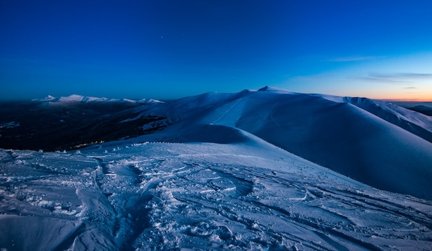 Stunning views of the ski slopes in the late winter evening. beauty concept of harsh northern nature and ski resort. copyspace