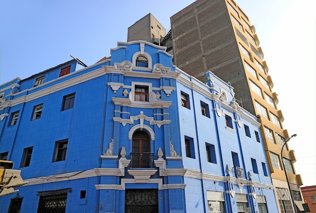 Stunning vivid blue and white vintage building in downtown lima, peru, south america