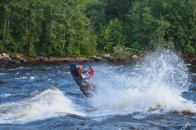 Stunt ride on a jet ski on a rough river natural light