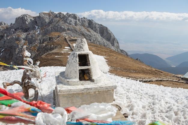 Stupa on high snow mountain, china