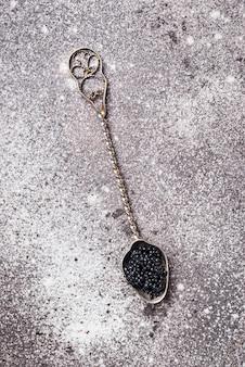 Sturgeon black caviar on spoon