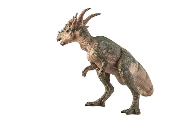 白い背景の上のstygimoloch恐竜。