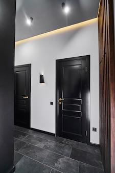 Style door handle on natural wooden door, door handle element