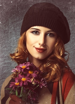 Style girl with flowers and bokeh at background.