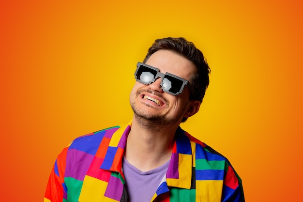 Style guy in 90s shirt and pixel sunglasses