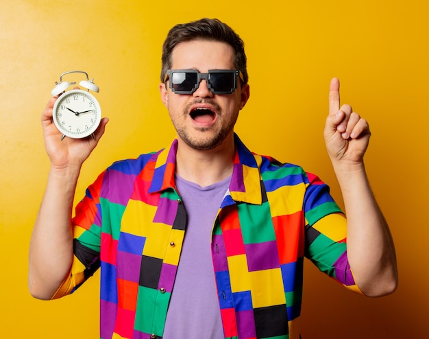 Style guy in 90s shirt with alarm clock