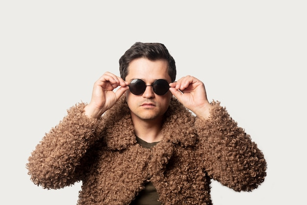 Style guy in fir coat with sunglasses