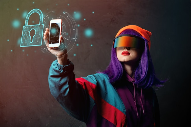 Style hacker woman in vr glasses is with mobile phone