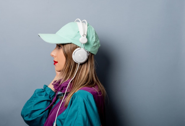 Style woman in 90s clothes style with headphones