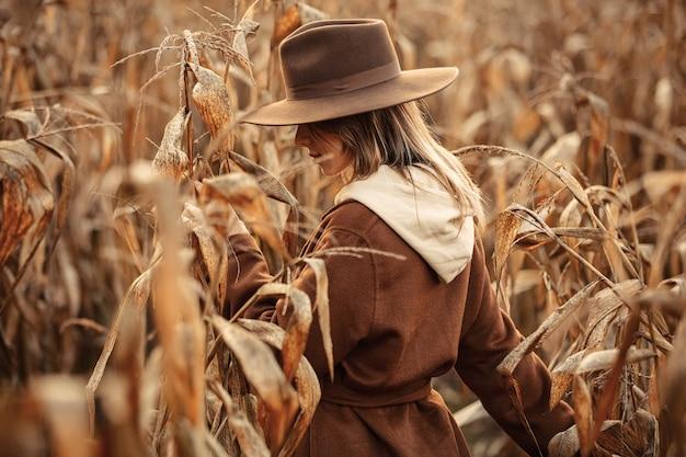 Style woman on corn field in autumn time season
