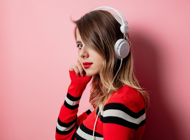 Style woman in striped sweater with headphones