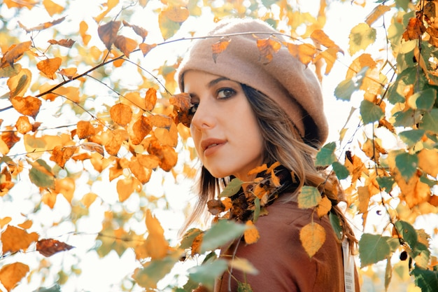 Style woman in vintage clothes near birch tree