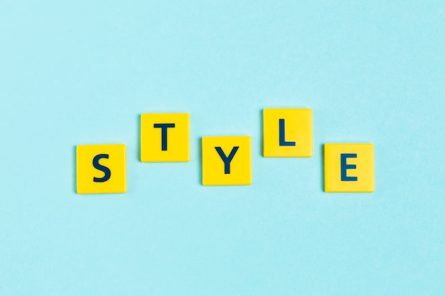 Style word on scrabble tiles