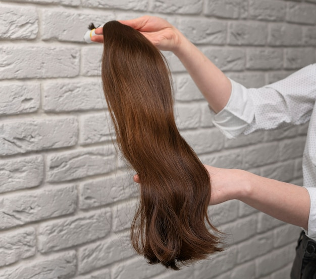 Styled hair extensions in beauty salon
