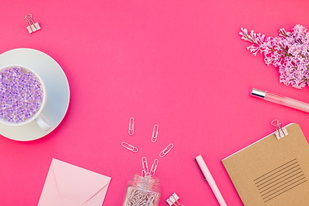 Styled pink feminine workspace flat lay