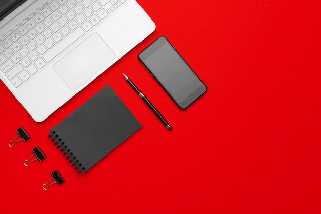 Styled stock photography red office desk table with stationery and office supplies