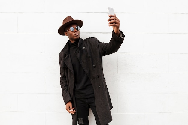 Stylish adult male taking a selfie