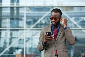 Stylish African American black businessman listens to the music
