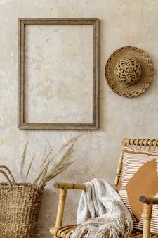 Стильная и бежевая композиция домашнего интерьера с креслом из ротанга, рамой, журнальным столиком, книгой, подносом, декором, растениями и личными аксессуарами в летней концепции.