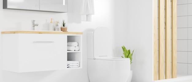 밝은 흰색 장식의 세면대 변기가 있는 미니멀한 캐비닛이 있는 세련된 욕실 인테리어