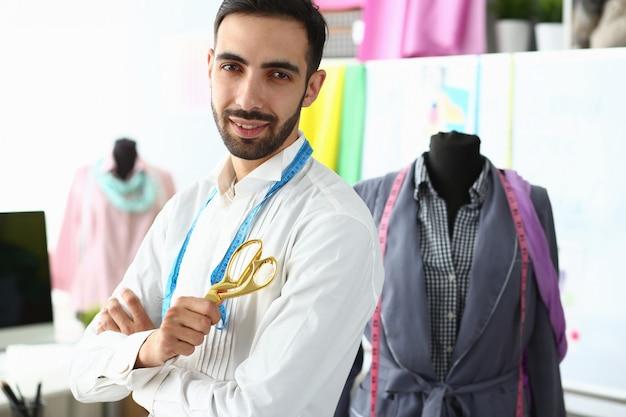 Stylish bearded man posing in his studio