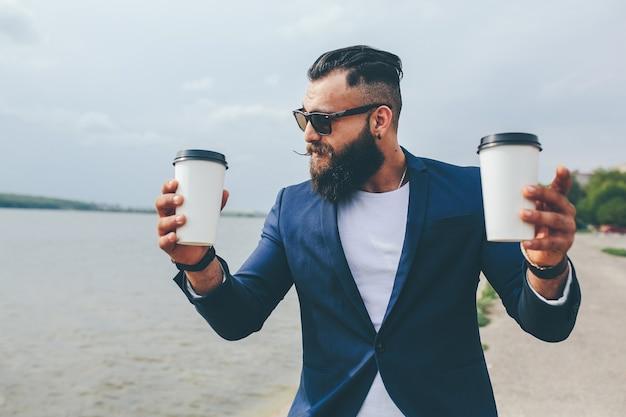 Stylish bearded men on the background of the lake