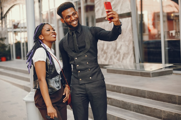 A stylish and beautiful dark-skinned couple in a city