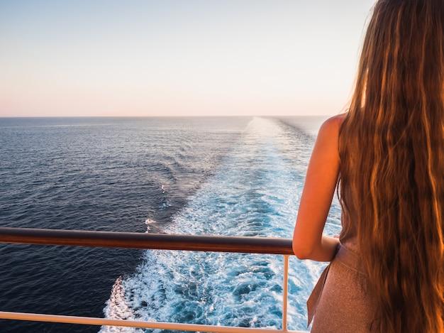 Stylish, beautiful woman on the empty deck