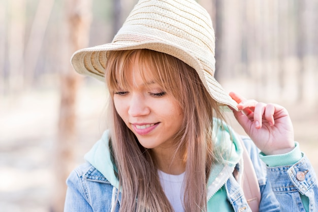 Stylish beautiful young woman wearing hat
