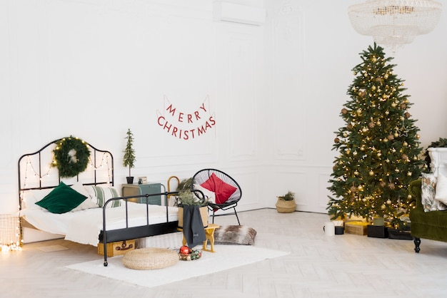 Stylish bedroom design with christmas decor in scandinavian or vintage style with a christmas tree