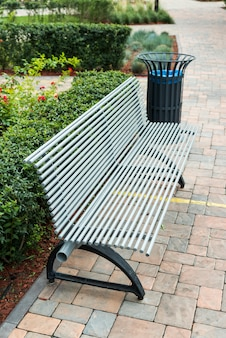 Stylish bench and metal trash can