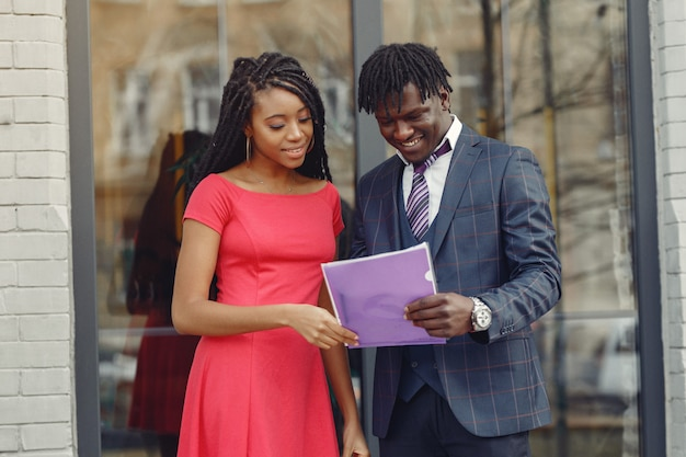 Stylish black couple have business conversation