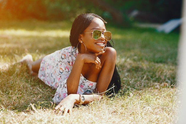 Stylish black girl in a park