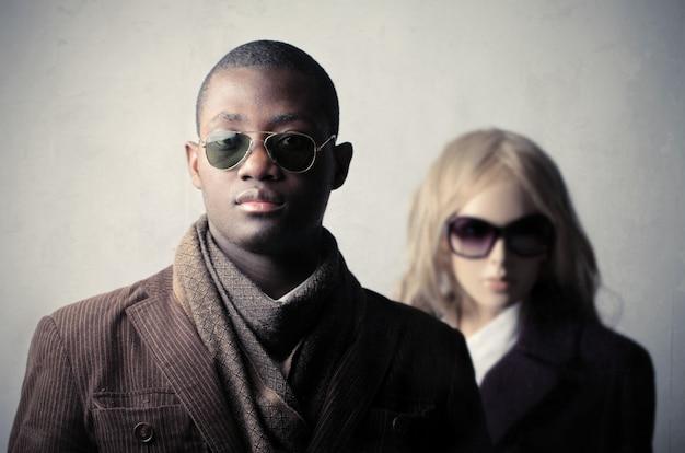 Stylish black man and blonde woman