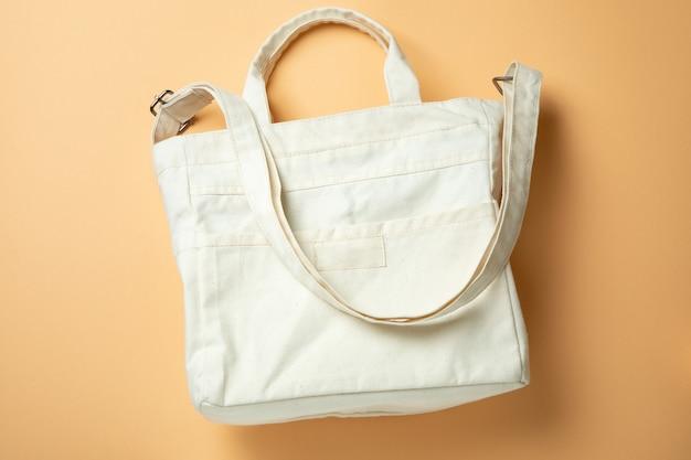 Stylish blank eco bag on beige background