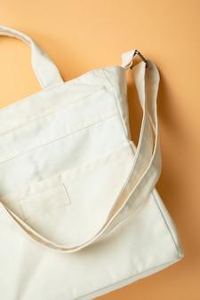 Stylish blank eco bag on beige surface