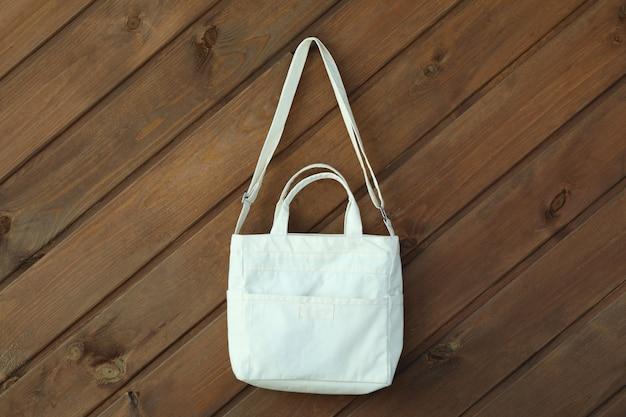Stylish blank eco bag on wooden surface