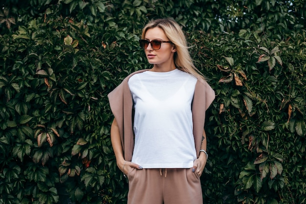 Stylish blonde girl wearing white t-shirt and glasses
