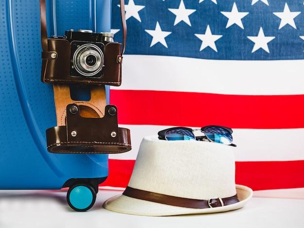 Stylish, blue suitcase, usa flag and vintage camera